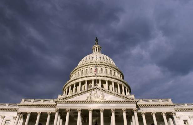 Dark clouds pass over the Capitol in Washington, Tuesday, Oct. 1, 2013. Congress plunged the nation into a partial government shutdown Tuesday as a long-running dispute over President Barack Obama's health care law stalled a temporary funding bill, forcing about 800,000 federal workers off the job and suspending most non-essential federal programs and services. (AP Photo/Susan Walsh)
